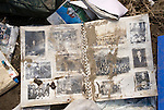 A Photo album lies among the rubble of Nobiru, Miyagi Prefecture, Japan on  25 March 20011. .Photographer: Robert Gilhooly