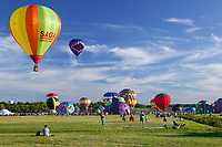 Spectators watch a balloon ascension during the 2004 Adirondacks Balloon Festival.