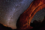 The Milky Way seems to reflect the geometry of an arch in Arches National Park, Utah.