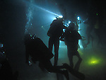 Kenting, Taiwan -- A group of divers on a night dive.<br />