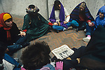 War protesters sitting in a circle and praying to stop the bloodshed protesting the US involvement in the Persian Gulf  and the build up to war against Irag January 15 deadline 1991 Seattle Washington State USA