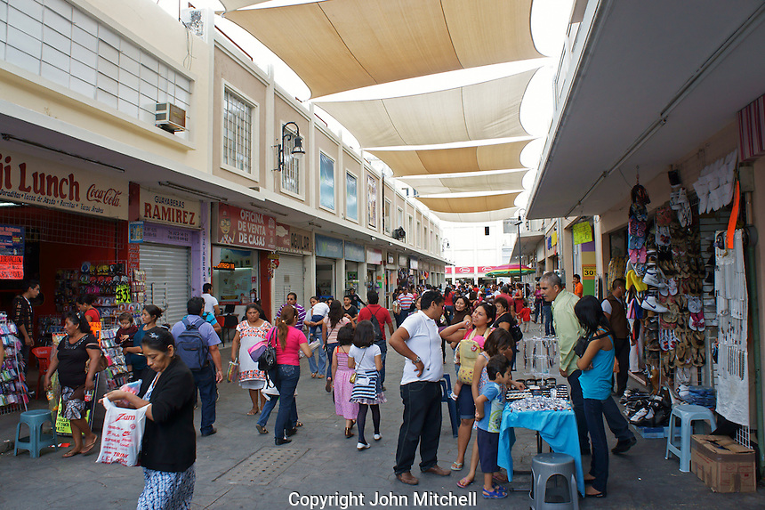 People in a crowded shopping mall in downtown Merida, Yucatan, Mexico...