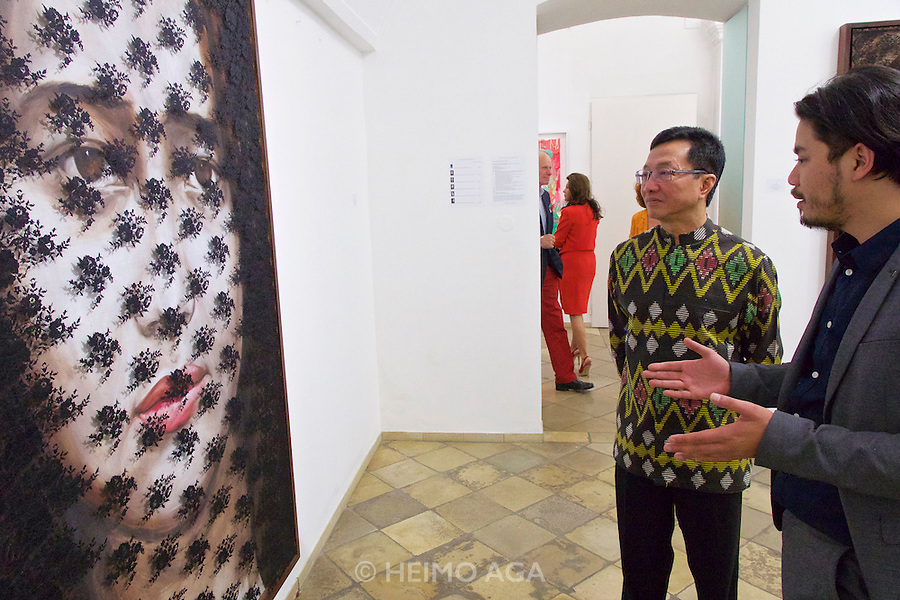 "Vienna, Austria. Galerie Suppan Contemporary. Vernissage of Zico Albaiquni (r., Indonesia), ""beyond the veil"". Zico speaking with H.E. Rachmat Budiman, Indonesian Ambassador to Austria."