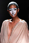 Malaysian designer Daniel Chong presents Romanticism of The Red Shoes at the Bangkok International Fashion Week.