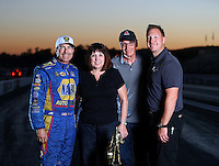 Nov 13, 2016; Pomona, CA, USA; NHRA funny car driver Ron Capps (left) and Ted Yerzyk and family pose for a portrait following the Auto Club Finals at Auto Club Raceway at Pomona. Mandatory Credit: Mark J. Rebilas-USA TODAY Sports