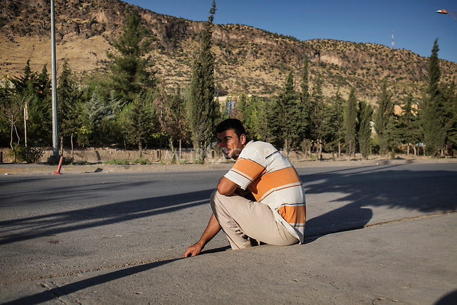 29/08/15. Shaqlawa, Iraq. -- Omar, 35 y.o. from Falluja. Every morning Omar sits on the side of the main street in Seirmaidan where Kurdish building companies collect workers when needed for the day. He will stay there from 6 in the morning until 11. When he works he usually makes 25-30.000 IQD.