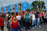 Cubans carry the national flags, waiting for a command to start waving, during the annual celebration of the Cuban Revolution anniversary in Santiago de Cuba, Cuba, 26 July 2008. The Cuban revolution began when the poorly armed Cuban rebels, led by Fidel Castro, attacked the Moncada Barracks in Santiago de Cuba on 26 July 1953. The attack was easily defeated and most of the rebels were captured and later executed by the Batista regime. Although Fidel Castro had been sentenced to 15 years of prison, after less than two years he was released, he went to Mexico and in 1956, back in Cuba again, his guerilla group started a new rebellion.