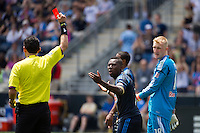 Freddy Adu (11) of the Philadelphia Union protests a red card from referee  Jorge Gonzalez  during the first half against the New York Red Bulls during a Major League Soccer (MLS) match at PPL Park in Chester, PA, on May 13, 2012.