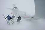 F7X  No 2  in Cold Soak Trial at Resolute Bay, Nunavut, Canada. The day with wind gusts of 60 kmh almost trapped the aircraft with snow. Crew check for snow infiltration during blizzard. April 2006. © Etienne de Malglaive.