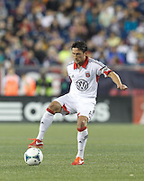 D.C. United midfielder John Thorrington (8) dribbles at midfield.  In a Major League Soccer (MLS) match, the New England Revolution (blue) tied D.C. United (white), 0-0, at Gillette Stadium on June 8, 2013.