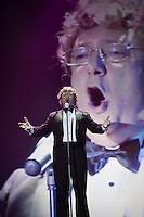 "Moscow, Russia, 25/09/2010..Russian competitor gastroenterologist Doctor Fedor Rytikov performs Puccini's aria ""Nessun Dorma"" in the finals of the Karaoke World Championships 2010, where amateur singers from around the world competed for prizes that included one million Russian dumplings."