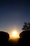 Sun setting between boulders, Coronado National Forest, Arizona