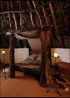 BNPS.co.uk (01202 558833)<br /> Pic: UpcottRoundhouse/BNPS<br /> <br /> Yabba-dabba-doo...<br /> <br /> Iron age four poster...made from tree trunks.<br /> <br /> A farmer has painstakingly recreated an Iron Age roundhouse to enable holidaymakers to release their inner Flintstone in the heart of the Devon countryside.<br /> <br /> Charles Cole has gone back over 2000 years to offer a back to basic's experience including a stone hearth fire, rudimentary plumbing, composting toilet and a six ton thatched roof to keep out the wind and rain.<br /> <br /> The amazing structure has been completely hand built by Charles and his family from materials sourced from their own farm and they have just opened up for bookings at &pound;170 a night..animal skins are optional.