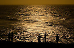 Fishermen at sunset in Cartagena, Colombia...Photo by Robert Caplin.