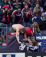 New England Revolution forward Zack Schilawski (15) celebrates his goal with teammates. In a Major League Soccer (MLS) match, the New England Revolution defeated DC United, 2-1, at Gillette Stadium on March 26, 2011.