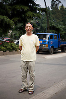 Yaming, a reporter, age 47, poses for a portrait in Nanjing. Response to 'What does China mean to you?': 'Responsible for hope, power and &quot;culture.&quot;'  Response to 'What is China's role in the future?': 'To make a bigger contribution to world peace.'