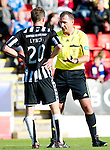 St Johnstone v St Mirren...11.09.10  .Sean Lynch gets a lecture from ref John McKendrick.Picture by Graeme Hart..Copyright Perthshire Picture Agency.Tel: 01738 623350  Mobile: 07990 594431