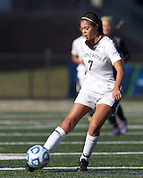 College of St Rose forward Amanda Vasquez (7) passes the ball. . In 2012 NCAA Division II Women's Soccer Championship Tournament First Round, College of St Rose (white) defeated Wilmington University (black), 3-0, on Ronald J. Abdow Field at American International College on November 9, 2012.