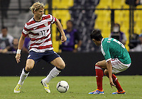 MEXICO CITY, MEXICO - AUGUST 15, 2012:  Brek Shea (USA) of the USA MNT brings the ball up to Severo Meza (5) of  Mexico during an international friendly match at Azteca Stadium, in Mexico City, Mexico on August 15. USA won 1-0.