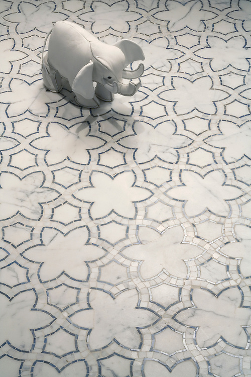 Reina, a handmade mosaic shown in polished Blue Macauba and honed Statuary Carrara, is part of the Miraflores Collection by Paul Schatz for New Ravenna.<br />