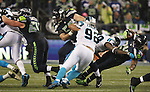 Seattle Seahawks  running back Marshawn Lynch (24) is taken down by Carolina Panthers linebacker Thomas Davie (58) in the NFC Western Division Playoffs at CenturyLink Field  on January 10, 2015 in Seattle, Washington. The Seahawks beat the Panthers 31-17. ©2015. Jim Bryant Photo. All Rights Reserved.