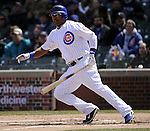 CHICAGO - APRIL  05:  Marlon Byrd #24 of the Chicago Cubs singles against the Arizona Diamondbacks on April 5, 2011 at Wrigley Field in Chicago, Illinois.  The Cubs defeated the Diamondbacks 6-5.  (Photo by Ron Vesely) Subject: Marlon Byrd