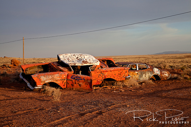 Wrecked autos lie near Route 66 at Meteor Crater Observatory in Arizona