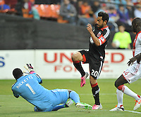 Carlos Ruiz (20) of D.C. United goes against Donovan Ricketts (1) of the Portland Timbers. The Portland Timbers defeated D.C. United 2-0, at RFK Stadium, Saturday May 25 , 2013.