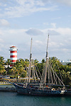 Grand Bahama Island, The Bahamas; the 'GHOST' ship docked in Bell Channel at Our Lucaya Resort with the Lucaya Lighthouse in the background