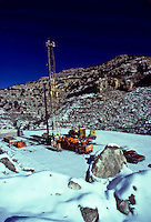 Stock photo of a workover rig in the mountains of Utah in winter.