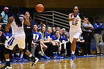 29 December 2015: Duke's Oderah Chidom (22) passes to Kyra Lambert (left). The Duke University Blue Devils hosted the Western Carolina University Catamounts at Cameron Indoor Stadium in Durham, North Carolina in a 2015-16 NCAA Division I Women's Basketball game.