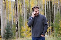 man on a cellphone in the middle of an Aspen Tree Forest in Santa Fe, NM