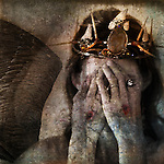 Shamanic angel martyr hiding face with stigmata on the hands.<br />