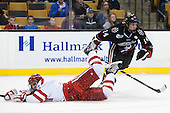 Matt Nieto (BU - 19), Braden Pimm (NU - 14) - The Northeastern University Huskies defeated the Boston University Terriers 3-2 in the opening round of the 2013 Beanpot tournament on Monday, February 4, 2013, at TD Garden in Boston, Massachusetts.
