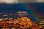 Shipwreck Mesa with a rainbow inside Bryce Canyon National Park in the late fall.