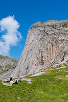 Steep granite cliff of Helvetestinden, Bunes beach, Lofoten islands, Norway