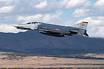 A McDonnel Douglas F-4E Phantom II based at Holloman Air Force Base in New Mexico takes to the air for a flight demonstration during the 2004 Reno National Championship Air Racer at Stead Field in Nevada. Over 5000 of the twin engine, tandem seat, mach 2 fighters were originally built starting in 1961 for the United States Navy and Air Force. The aircraft was also exported to Australia, Egypt, Germany, Greece, Iran, Israel, Japan, South Korea, Spain, Turkey, and the United Kingdom. The United States retired its last Phantom in 1996 and export countries are the only operators of the aircraft type. Though the aircraft pictures is in U.S. markings it is actually flown by German Air Force pilots for training.Though the aircraft pictured is in U.S. markings it is actually a German aircraft flown by German Air Force pilots for training.
