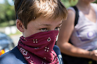 Landrum Redman, age 11 from West Jefferson, North Carolina, attends the March on Wall Street South protest on Sunday, September 2, 2012 in Charlotte, NC.