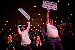 Elton Harris, right, and other supporters cheer for GOP presidential candidate Rep. Ron Paul at the Grand Sierra Resort in Reno, Nev., February 2, 2012.