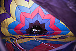 A hot air balloon is slowly inflated at the 2008 Shenandoah Valley Hot Air Balloon and Wine Festival at Historic Long Branch in Millwood, Virginia.