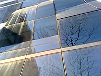 reflections in angled windows of new condo building off west side in west village