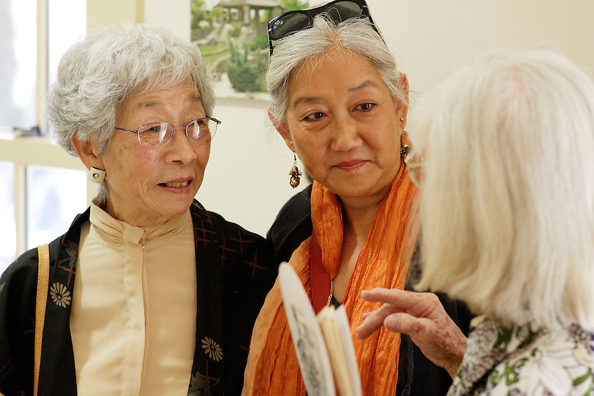 Mabel Jingu Enkoji and a relative mingle with event attendees during the grand re-opening of the Jingu House, Saturday, Oct. 22, 2011, at the Japanese Tea Garden in San Antonio, Texas, USA. (Darren Abate/pressphotointl.com)