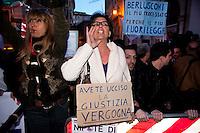 Roma, 13 Aprile 2011..Piazza Montecitorio.Manifestazione del popolo viola davanti al Parlamento contro l'amnistia mascherata del processo breve durante la votazione alla Camera dei deputati.Partecipano i parenti delle vittime del terremoto de L'Aquila e della strage di Viareggio.La protesta dei manifestanti all'annuncio della votazione favorevole al governo della legge