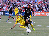 D.C. United forward Dwayne De Rosario (7) goes against Columbus Crew defender Carlos Mendes (4) D.C. United defeated The Columbus Crew 1-0 at RFK Stadium, Saturday August 4, 2012.