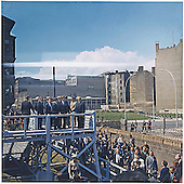 United States President John F. Kennedy mounts a platform overlooking Berlin Wall in West Berlin, West Germany on June 26, 1963.<br /> Mandatory Credit: Robert Knudsen/White House via CNP