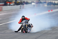 Feb 11, 2017; Pomona, CA, USA; NHRA top fuel nitro Harley rider Tii Tharpe nearly loses control as he locks his brakes during qualifying for the Winternationals at Auto Club Raceway at Pomona. Mandatory Credit: Mark J. Rebilas-USA TODAY Sports