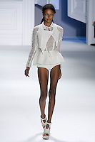 Jasmine Tookes walks runway in a White perforated super pique cropped vest over white textured gauze long sleeve pullover, and White super pique boy shorts, by Vera Wang, for the Vera Wang Spring 2012 collection, during Mercedes-Benz Fashion Week Spring 2012.