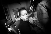 Wroclaw 02.02.2007 Poland.<br /> Patryk Dec, 6 in his room with protection mask.<br /> Clinical Hospital, oncology and haematology departmend. This is one of the important Haematologic Hospital in all over Poland, however hospital board stopped to discharge a rising debt. In this connection authorities must close hospital, but goverment had no idea what should do with terminaly ill children.<br /> (Photo: Adam Lach / Napo Images)<br /> <br /> Akedemicki Szpital Kliniczny, oddzial onkologii i hematologii. Temu jednemu z najwazniejszych w Polsce osrodkowi szpitalnemu grozi zamkniecie w powodu dlugow, ktore niezaleznie od wplat NFZ-tu regularnie sciaga komornik. Z calej Polski ludzie charytatywnie wplacaja pieniadze by uratowac szpital i los dzieci dla ktorych to miejsce jest jedynym ratunkiem.