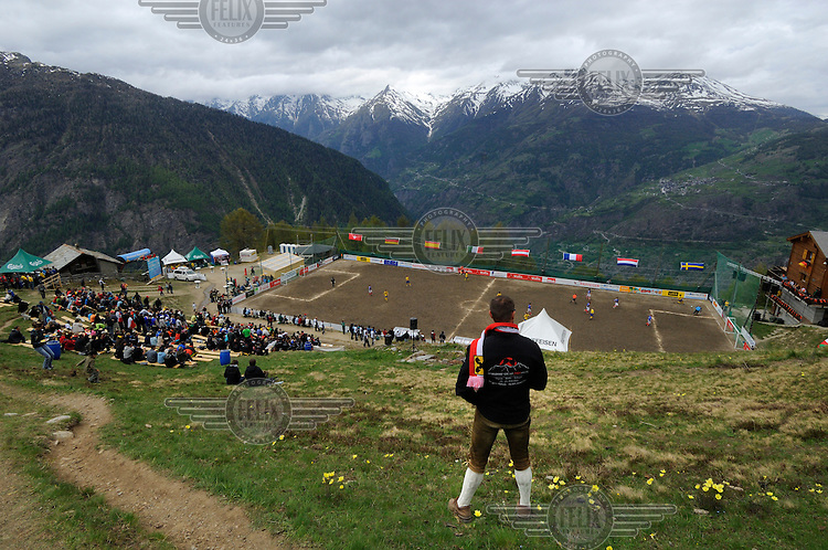 One of over a hundred travelling Austrian supporters looking down on an ongoing group match in the other official Euro 2008 football tournament: the European Championship of Mountain Villages. The tournament was held at the summer training ground of hosts FC Gspon, standing at 2008 metres above sea-level,  and surrounded by 4000 metre alpine peaks. It is the highest football pitch in Europe, and reachable only by cable car, or a long walk. Amateur league teams from eight countries took part.