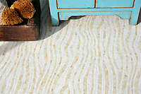 Dune, a tumbled jewel glass mosaic shown in Absolute White and Agate, is part of the Metamorphosis Collection by Sara Baldwin for New Ravenna Mosaics.